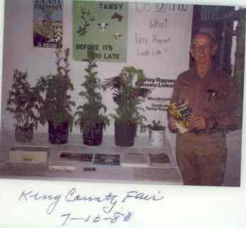 1980 photo of a noxious weed education table at the King County Fair from the files of the King County Noxious Weed Control Board