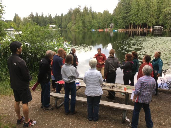 People learning how to look for aquatic weeds at Beaver Lake.